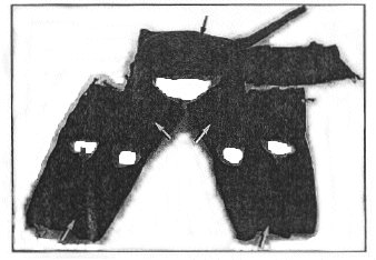 Figure 2. Inflated anti-G suit. The distensible bladders are indicated by the arrows.